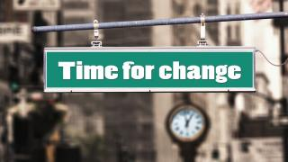 "Sign that reads ""time for change"""