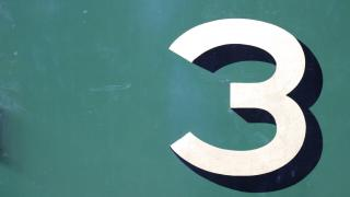 The number 3 on a green background.